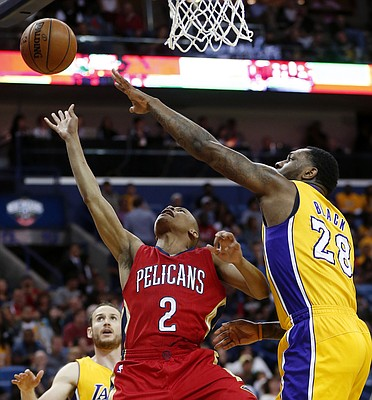 New Orleans Pelicans guard Tim Frazier (2) goes to the basket against Los Angeles Lakers center Tarik Black (28) during the first half of an NBA basketball game in New Orleans, Friday, April 8, 2016. (AP Photo/Gerald Herbert)