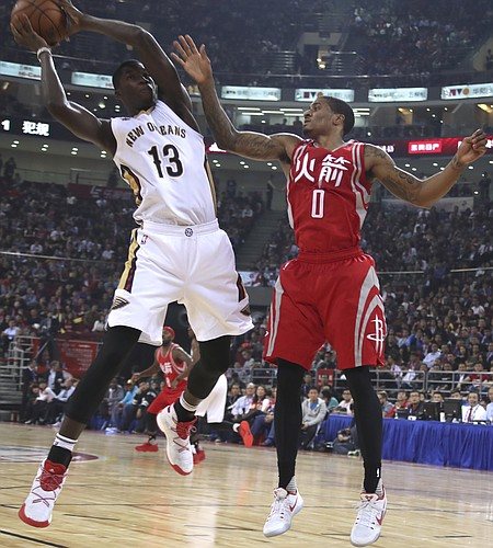 Cheick Diallo of the New Orleans Pelicans keeps the ball away from Gary Payton II of the Houston Rockets during a preseasons NBA game in Beijing, China, Wednesday, Oct. 12, 2016. (AP Photo/Ng Han Guan)