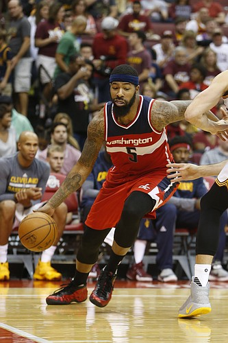 Washington Wizards' Markieff Morris plays against the Cleveland Cavaliers during an NBA preseason basketball game Tuesday, Oct. 18, 2016, in Columbus, Ohio. (AP Photo/Jay LaPrete)