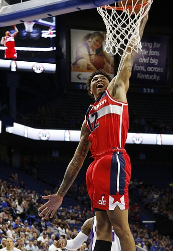 Washington Wizards forward Kelly Oubre Jr. (12) dunks during an NBA preseason basketball game against the Sacramento Kings on Saturday, Oct. 15, 2016, in Lexington, Ky. (AP Photo/James Crisp)
