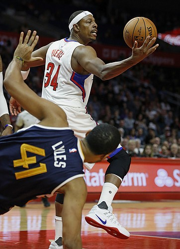 Los Angeles Clippers forward Paul Pierce, right, takes the ball away from Utah Jazz forward Trey Lyles, left, during the first half of an NBA preseason basketball game in Los Angeles, Monday, Oct. 10, 2016. (AP Photo/Alex Gallardo)