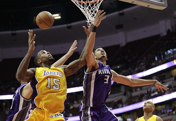 Los Angeles Lakers' Thomas Robinson, left, and Sacramento Kings' Skal Labissiere fight for a rebound during the second half of an NBA preseason basketball game Tuesday, Oct. 4, 2016, in Anaheim, Calif. The Lakers won 103-84. (AP Photo/Jae C. Hong)