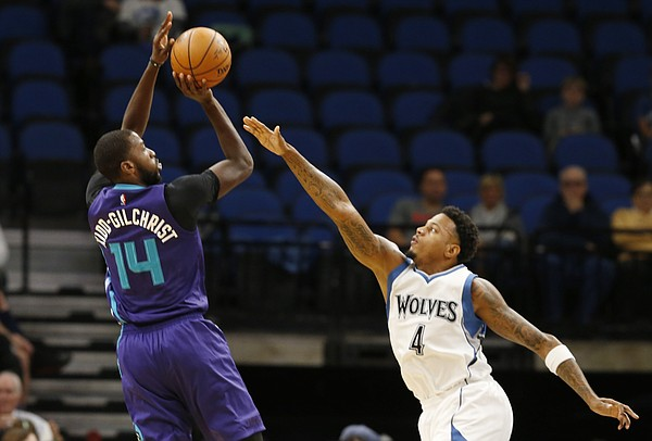 Charlotte Hornets' Michael Kidd-Gilchrist shoots over Minnesota Timberwolves' Brandon Rush during the first quarter of an NBA preseason basketball game Friday, Oct. 21, 2016, in Minneapolis. (AP Photo/Jim Mone)