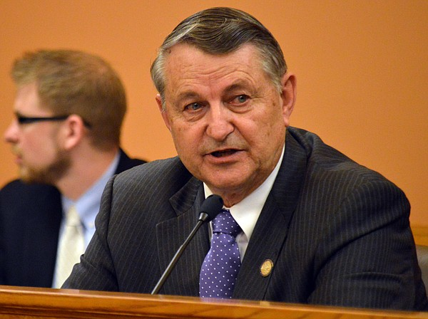 In this file photo from May 30, 2015, Richard Carlson, legislative liaison for the Kansas Department of Revenue, speaks during a meeting of GOP state senators on tax issues at the Statehouse in Topeka, Kan. (AP Photo/John Hanna)