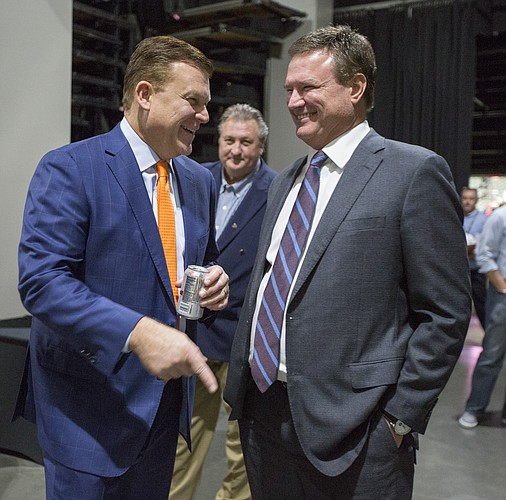Kansas head coach Bill Self laughs with first-year Oklahoma State head coach Brad Underwood during Big 12 Media Day on Tuesday, Oct. 25, 2016 at Sprint Center.