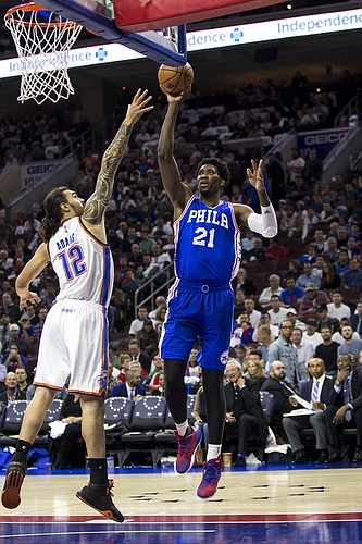Philadelphia 76ers' Joel Embiid, right, shoots the ball with Oklahoma City Thunder's Steven Adams, left, defending during the second half of an NBA basketball game, Wednesday, Oct. 26, 2016, in Philadelphia. The Thunder won 103-97. (AP Photo/Chris Szagola)
