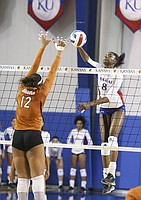 Kansas right side hitter Kelsie Payne (8) gets up for a hit against Texas middle blocker Morgan Johnson (12) during the second set on Saturday, Oct. 29, 2016 at the Horejsi Center.