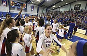 The Kansas Jayhawks, led by senior setter Maggie Anderson (19) go crazy after beating the Longhorns in five sets on Saturday, Oct. 29, 2016 at the Horejsi Center.