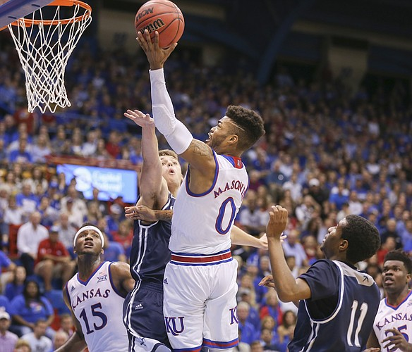 Kansas guard Frank Mason III (0) gets to the bucket against Washburn during the first half, Tuesday, Nov. 1, 2016 at Allen Fieldhouse.