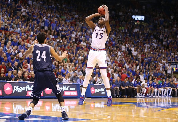 Kansas forward Carlton Bragg Jr. (15) pulls up for a three against Washburn forward Brandon Fagins (24) during the first half, Tuesday, Nov. 1, 2016 at Allen Fieldhouse.