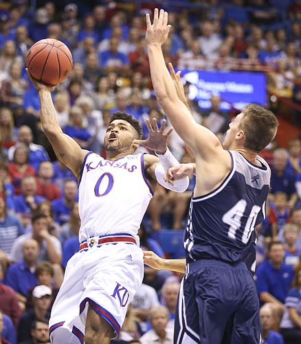 Kansas guard Frank Mason III (0) hangs for a shot against Washburn forward David Salach (40) during the first half, Tuesday, Nov. 1, 2016 at Allen Fieldhouse.