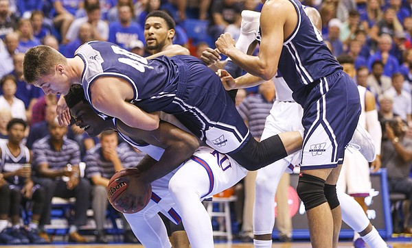 Washburn forward David Salach (40) falls over the top of Kansas center Udoka Azubuike (35) during the first half, Tuesday, Nov. 1, 2016 at Allen Fieldhouse.
