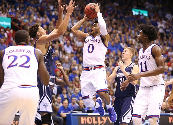 Kansas guard Frank Mason III (0) hangs for a shot in the paint against Washburn during the first half, Tuesday, Nov. 1, 2016 at Allen Fieldhouse.