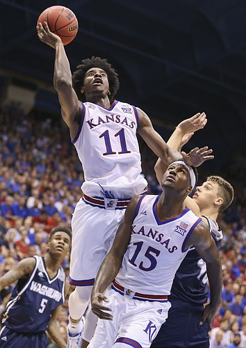 Kansas guard Josh Jackson (11) gets up for a shot over Washburn forward Jeremy Lickteig and teammate Carlton Bragg Jr. (15) during the second half, Tuesday, Nov. 1, 2016 at Allen Fieldhouse.