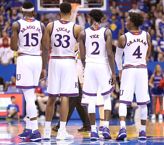 Kansas forward Carlton Bragg Jr. (15), Kansas forward Landen Lucas (33), Kansas guard Lagerald Vick (2) and Kansas guard Devonte' Graham (4) converse together during a break from action in the second half, Tuesday, Nov. 1, 2016 at Allen Fieldhouse.