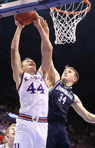 Kansas forward Mitch Lightfoot (44) is fouled by Washburn forward Jeremy Lickteig (34) during the second half, Tuesday, Nov. 1, 2016 at Allen Fieldhouse.