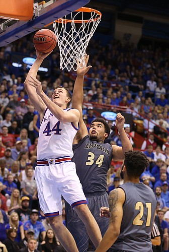 Kansas forward Mitch Lightfoot (44) gets a bucket past Emporia State forward Garin Vandiver (34) and guard Jevon Taylor (21) during the first half, Sunday, Nov. 6, 2016 at Allen Fieldhouse.