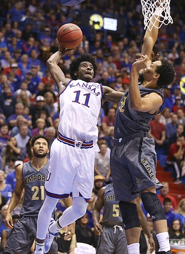 Kansas guard Josh Jackson (11) pulls back for a near dunk against Emporia State forward Jawan Emery (32) during the first half, Sunday, Nov. 6, 2016 at Allen Fieldhouse. Emery fouled Jackson on the play.