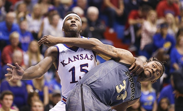 Kansas forward Carlton Bragg Jr. (15) gets physical with Emporia State forward Terrence Sardin (33) during the first half, Sunday, Nov. 6, 2016 at Allen Fieldhouse.