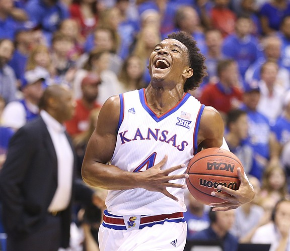 Kansas guard Devonte' Graham (4) smiles after a near breakaway and a steal during the first half, Sunday, Nov. 6, 2016 at Allen Fieldhouse.