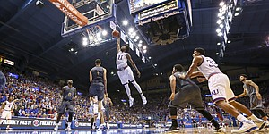 Kansas guard Josh Jackson (11) soars in for a jam over Emporia State forward Stephaun Limuel (1) during the second half, Sunday, Nov. 6, 2016 at Allen Fieldhouse.