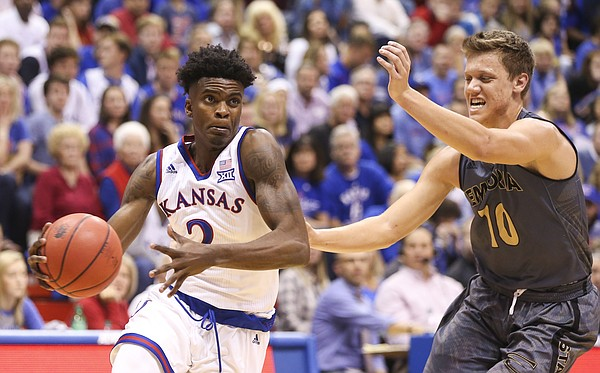 Kansas guard Lagerald Vick (2) drives against Emporia State guard Jay Temaat (10) during the second half, Sunday, Nov. 6, 2016 at Allen Fieldhouse.