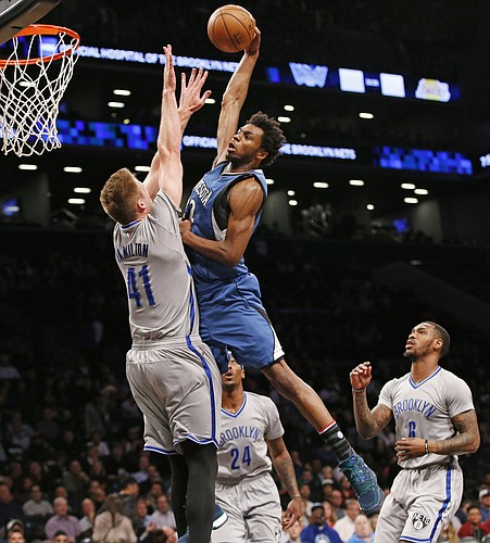 Minnesota Timberwolves forward Andrew Wiggins (22) shoots over Brooklyn Nets center Justin Hamilton (41) during the first half of an NBA basketball game, Tuesday, Nov. 8, 2016, in New York. (AP Photo/Kathy Willens)