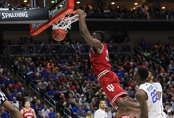 Indiana's Thomas Bryant (31) dunks over Kentucky's Alex Poythress (22) during a second-round men's college basketball game in the NCAA Tournament in Des Moines, Iowa, Saturday, March 19, 2016. Indiana won 73-67.