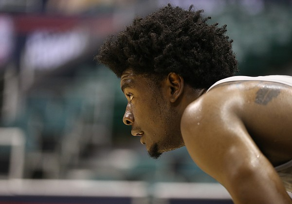 Kansas guard Josh Jackson gets a break on the sidelines as the team works on perimeter defense during a practice on Thursday, Nov. 10, 2016 at Stan Sheriff Center in Honolulu, Hawaii.