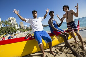 Kansas players Frank Mason III, left, LaGerald Vick and Mitch Lightfoot are pictured on a catamaran on Thursday, Nov. 10, 2016 at Waikiki Beach in Honolulu. The team was given some free time after practice to enjoy the beach.