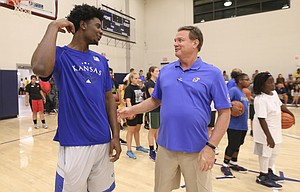 Kansas guard Josh Jackson jokes around with head coach Bill Self during a kid's clinic on Wednesday, Nov. 9, 2016 at the Joint Base Pearl Harbor-Hickam fitness center in Honolulu, Hawaii.