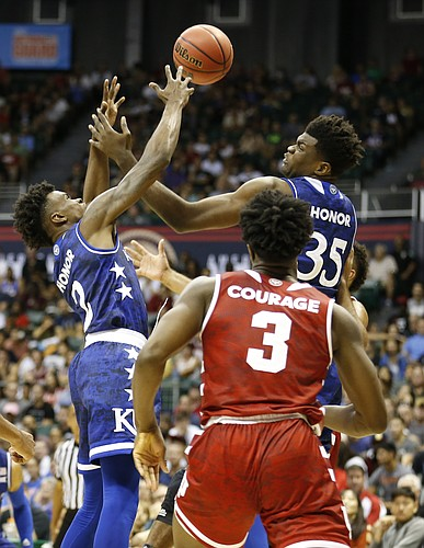Kansas guard Lagerald Vick (2) and Kansas center Udoka Azubuike (35) fight for a rebound over Indiana forward OG Anunoby (3) during the first half of the Armed Forces Classic at Stan Sheriff Center, on Friday, Nov. 11, 2016 in Honolulu, Hawaii.