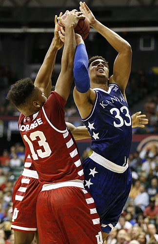 Indiana forward Juwan Morgan (13) gets a hand on a shot from Kansas forward Landen Lucas (33) during the first half of the Armed Forces Classic at Stan Sheriff Center, on Friday, Nov. 11, 2016 in Honolulu, Hawaii.