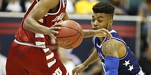 Kansas guard Frank Mason III (0) looks to swipe a ball controlled by Indiana guard Curtis Jones (0) during the first half of the Armed Forces Classic at Stan Sheriff Center, on Friday, Nov. 11, 2016 in Honolulu, Hawaii.