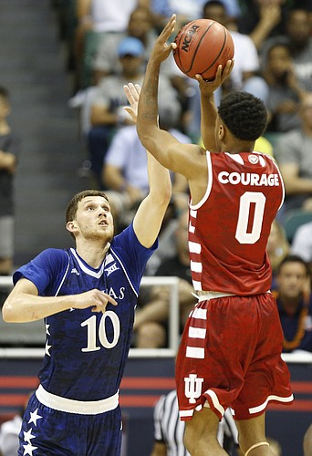 Kansas guard Sviatoslav Mykhailiuk (10) defends against a shot from Indiana guard Curtis Jones (0) during the first half of the Armed Forces Classic at Stan Sheriff Center, on Friday, Nov. 11, 2016 in Honolulu, Hawaii.