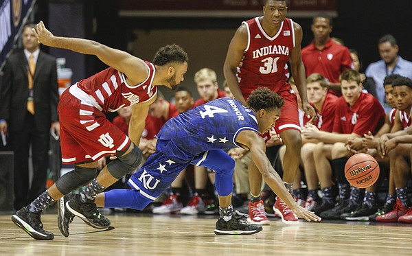 Kansas guard Devonte' Graham (4) chases down a steal from Indiana guard James Blackmon Jr. (1) during the second half of the Armed Forces Classic at Stan Sheriff Center, on Friday, Nov. 11, 2016 in Honolulu, Hawaii.