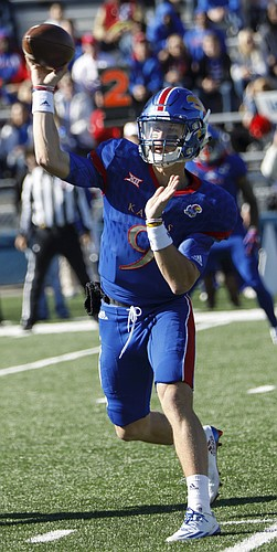 Kansas freshman quarterback Carter Stanley fires a pass during Saturday's game against Iowa State on Nov. 12, 2016 at Memorial Stadium. It was the first start of Stanley's career.