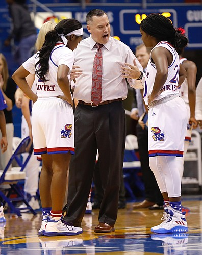 Kansas head coach Brandon Schneider talks with guard McKenzie Calvert (2) left and Jayde Christopher (20) during a timeout in the Jayhawks game against the Missouri State Lady Bears Sunday, Nov. 13, 2016 at Allen Field House.