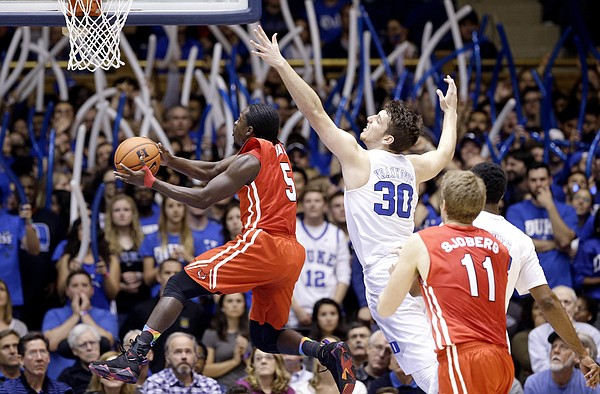 Marist guard Khallid Hart (5) drives past Duke center Antonio Vrankovic (30) during the first half of an NCAA college basketball game in Durham, N.C., Friday, Nov. 11, 2016. Duke won 94-49.