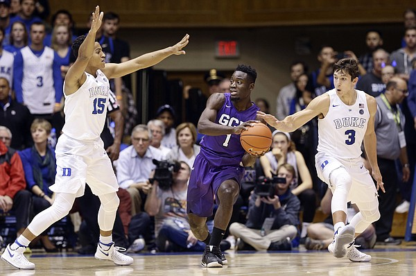 Duke's Frank Jackson (15) and Grayson Allen (3) guard Grand Canyon's Fiifi Aidoo (1) during the first half of an NCAA college basketball game in Durham, N.C., Saturday, Nov. 12, 2016. Duke won 96-61.