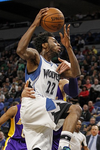 Minnesota Timberwolves forward Andrew Wiggins (22) drives to the basket and is fouled by Los Angeles Lakers center Timofey Mozgov (20) in the first half of an NBA basketball game, Sunday, Nov. 13, 2016, in Minneapolis. (AP Photo/Bruce Kluckhohn)