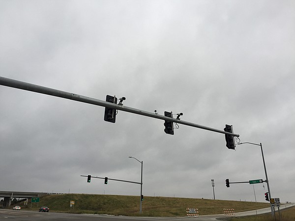 License plate scanners are pictured attached to the top of the traffic signals at the SLT and Iowa Street interchange.