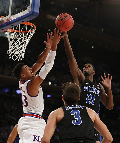 Kansas forward Landen Lucas (33) battles for a rebound with Duke forward Amile Jefferson (21) during the first half of the Champions Classic on Tuesday, Nov. 15, 2016 at Madison Square Garden in New York.