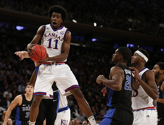 Kansas guard Josh Jackson (11) comes away with a  rebound during the first half of the Champions Classic on Tuesday, Nov. 15, 2016 at Madison Square Garden in New York.