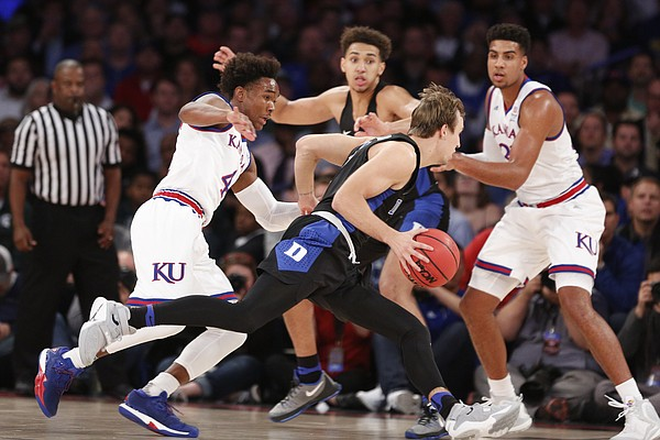 Kansas guard Devonte' Graham (4) chases after Duke guard Luke Kennard (5) during the first half of the Champions Classic on Tuesday, Nov. 15, 2016 at Madison Square Garden in New York.