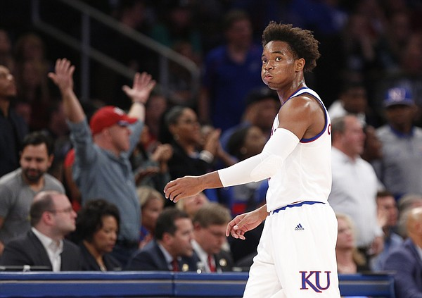 Kansas guard Devonte' Graham (4) shows his frustration after a foul by the Jayhawks during the first half of the Champions Classic on Tuesday, Nov. 15, 2016 at Madison Square Garden in New York.