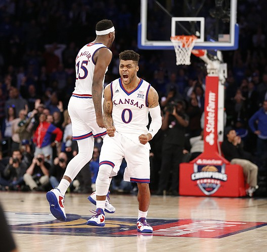 Kansas guard Frank Mason III (0) roars after hitting the final shot for a 77-75 win over Duke during the Champions Classic on Tuesday, Nov. 15, 2016 at Madison Square Garden in New York.