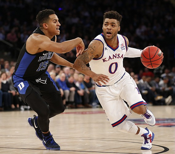 Kansas guard Frank Mason III (0) drives against Duke guard Frank Jackson (15) during the second half of the Champions Classic on Tuesday, Nov. 15, 2016 at Madison Square Garden in New York.