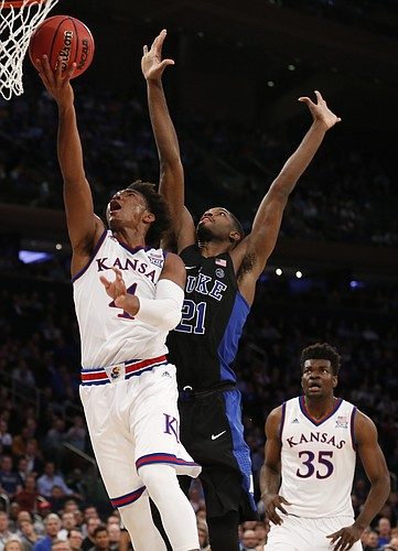 Kansas guard Devonte' Graham (4) gets in for a bucket past Duke forward Amile Jefferson (21) during the second half of the Champions Classic on Tuesday, Nov. 15, 2016 at Madison Square Garden in New York.