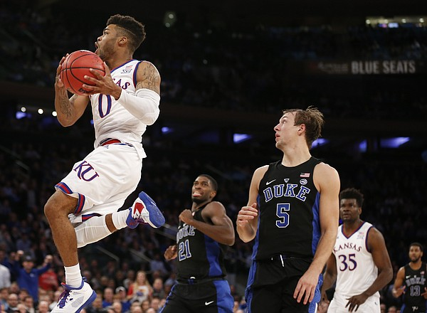 Kansas guard Frank Mason III (0) gets in for a bucket past Duke guard Luke Kennard (5) during the second half of the Champions Classic on Tuesday, Nov. 15, 2016 at Madison Square Garden in New York.